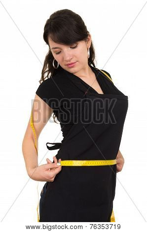 beautiful slim fit young girl holding measuring tape around her waist