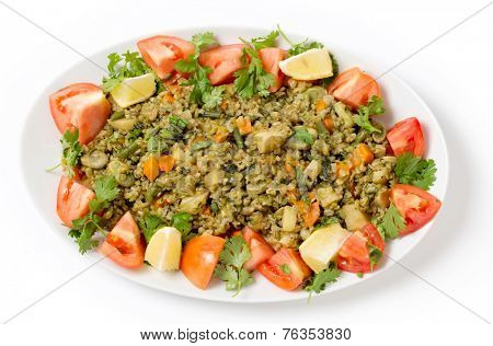 Traditional Egyptian freek vegetable pilaf, with the roasted wheat grain taking the place of rice, as freekeh (or frikeh) is cooked in stock with chopped veg, seen from above.