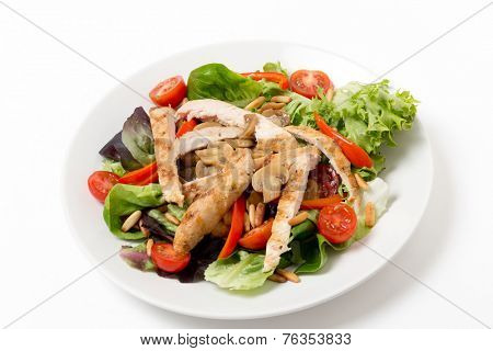 Warm chicken and mushroom salad, with  lettuce, cherry tomatoes, pine-nuts and strips of pepper