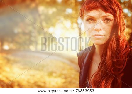 Woman With Freckles And Red Long Hair In Fall Park