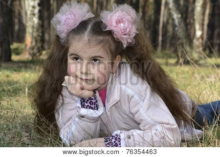 Spring In The Forest Girl With Long Hair With A Large Bow.