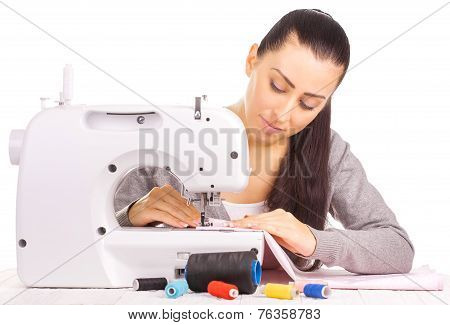 happy seamstress sewing. isolated on the white