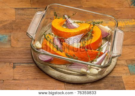 Sliced Pumpkin With Red Onion, Garlic And Thyme