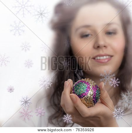 Beautiful Christmas Girl Holding In Own Hand Toy