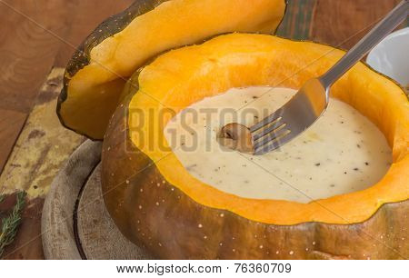 Cheese Fondue In A Roasted Pumpkin With Chestnut Mushroom On A Fork