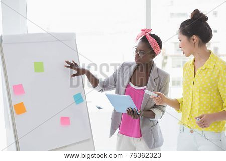 Young creative women brainstorming together in creative office