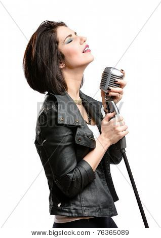 Half-length portrait of rock musician wearing leather jacket and keeping static mic, isolated on white. Concept of rock music and rave