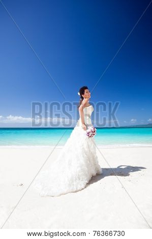 Beautiful Bride On White Sandy Beach, Smiling And Feeling Happiness