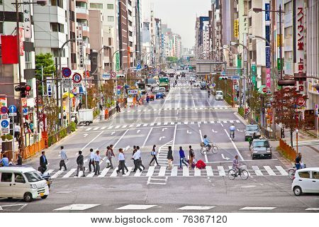 TOKYO, JAPAN - OCT 27, 2014: People walking through Asakusa district in Tokyo, Japan.