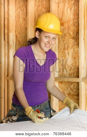 Woman construction worker reviewing plans