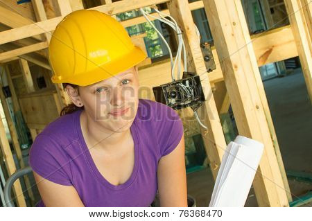 Woman construction worker looking frustrated
