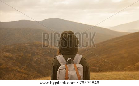 Woman Enjoying Landscape Of Autumn Mountains