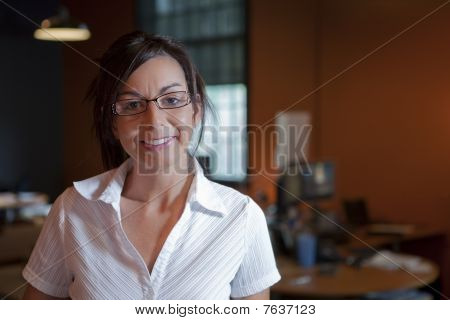 Female Office Worker Wearing Glasses And Smiling