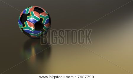 Glossy South African Soccer Ball On Golden Metal Surface