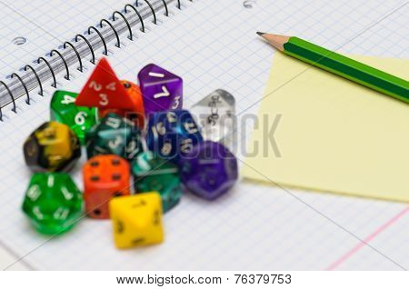 Open Exercise Book With Sticky Card, Pencil And Role Playing Dices