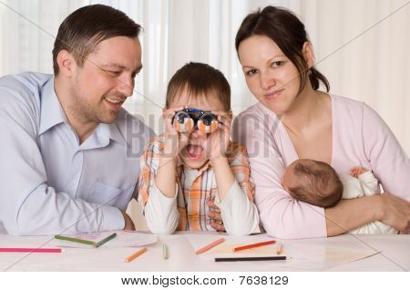 Family Sitting At The Table
