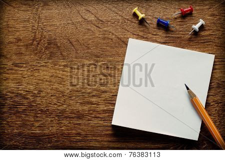 Office Supplies On Wooden Surface With Copy Space