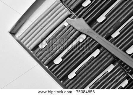 plasticine box om white abstract background in black and white