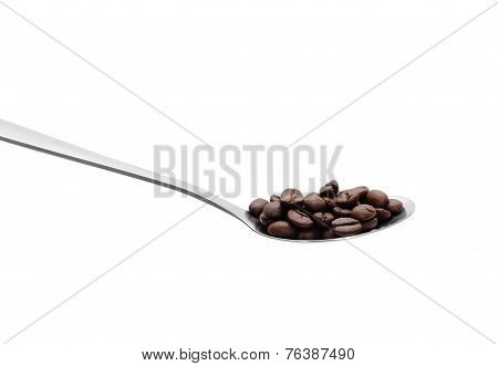Spoon With Coffee Beans. Isolated Photo.