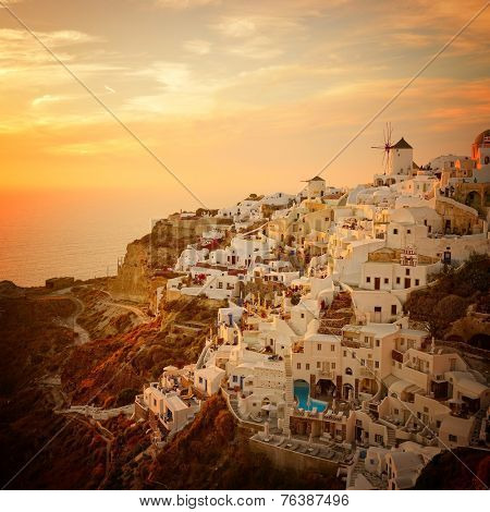sunset over famous blue and white city Oia,Santorini