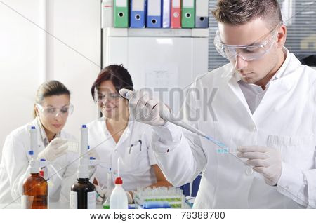 Attractive Young Phd Students Scientists Observing In The Laboratory