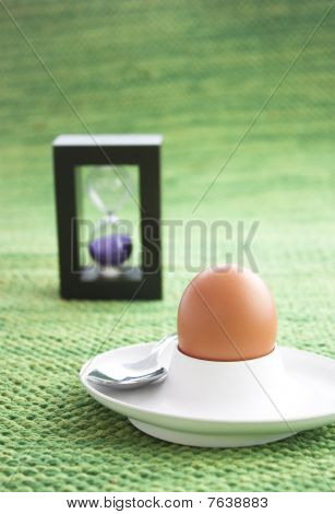 Boiled egg with sand timer.