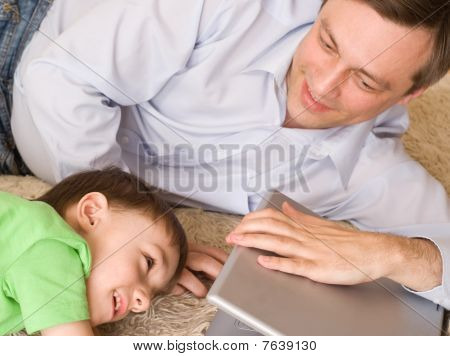 Father Playing With  Son With Laptop