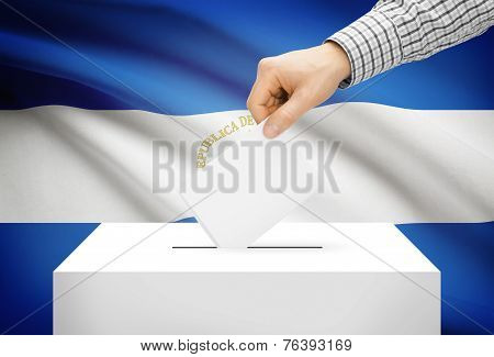 Voting Concept - Ballot Box With National Flag On Background - Nicaragua