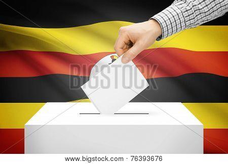 Voting Concept - Ballot Box With National Flag On Background - Uganda