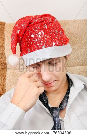 Tired Teenager In Santa Hat