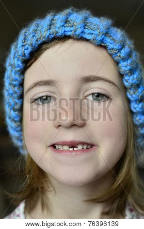 Little girl smiling portrait missing front tooth