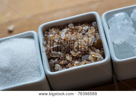 white and brown sugar on wooden table.