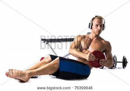Muscular Shirtless Young Man Exercising With Weights Isolated