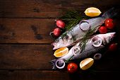 stock photo of bass fish  - Fresh bass fish on the wooden background with blank spaceselective focus - JPG