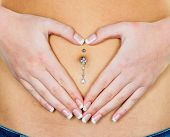 picture of piercings  - a woman has abdominal pain or stomach pain - JPG