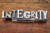 stock photo of integrity  - integrity word in vintage metal type printing blocks over grunge wood - JPG