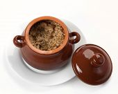 picture of pot roast  - roast from pork in a brown clay pot on a white plate - JPG
