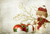 stock photo of snowmen  - Vintage Christmas card with snowman and Christmas decoration in the snow - JPG
