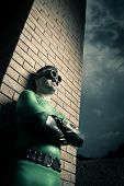 image of cross-dressing  - Cool superhero with arms crossed leaning to a brick wall - JPG