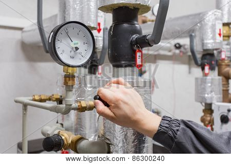 Technician checking water pressure