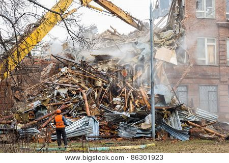 Excavator Demolishes Old School Building