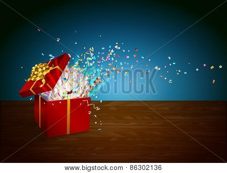 Open gift with fireworks from confetti on wooden table.
