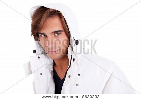 Portrait Of A Young Man With A Hood , In Autumn/winter Clothes, Isolated On White. Studio Shot