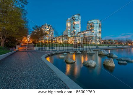 House building and city concept: evening outdoor urban view of modern real estate homes.