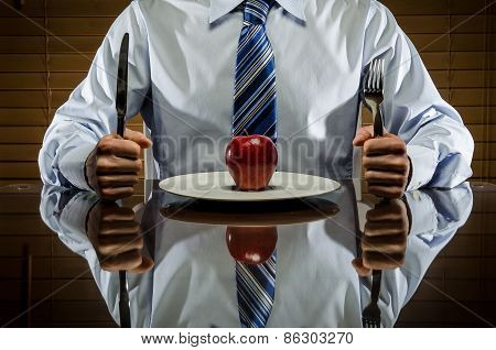 Business man with an apple on a plate