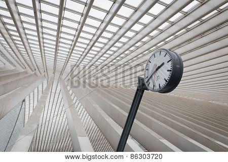 A clock in an interior of a train station