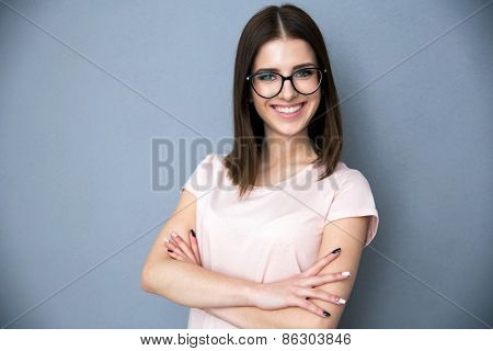 Portrait of a smiling young woman with arms folded