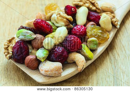 Varieties Of Dried Fruits And Nuts On Wooden Spoon.