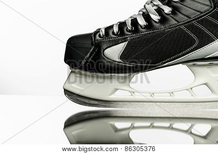 Hockey skate on white