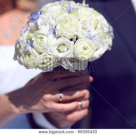 Closeup Hands Of Bride And Groom Holding Wedding White Bouquet Flowers